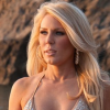 Gretchen Rossi models her new swimwear range in sunset shoot