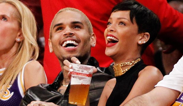 Rihanna And Chris Brown Get Cozy At Lakers Game