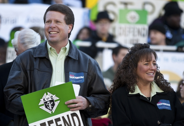Jim Bob and Michelle Duggar show their support for Rick Santorum at a