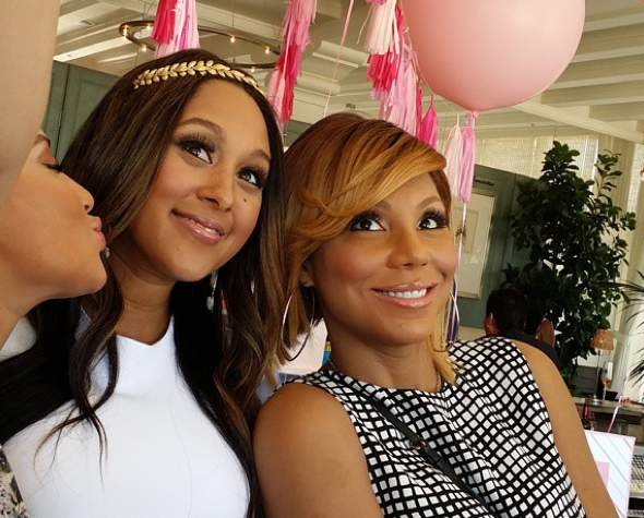 Photos See Tamera Mowry Housleys Pretty In Pink Baby Shower