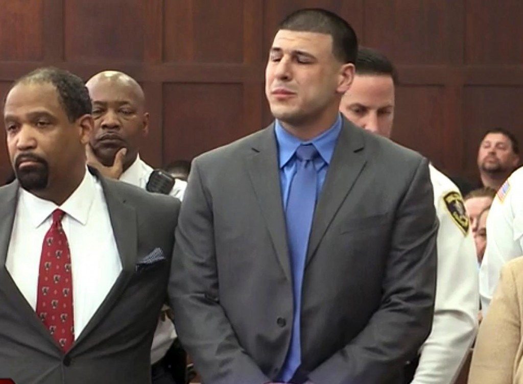 Aaron Hernandez reacts as he is pronounced not guilty in a double murder case in Boston on Friday