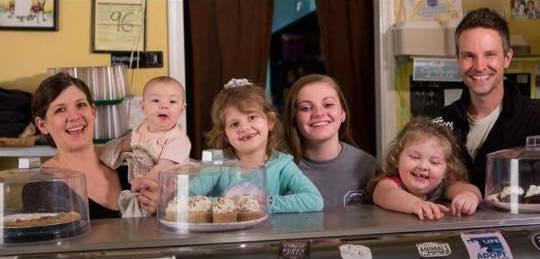 Kristie & Adam Jeffrey with their children.