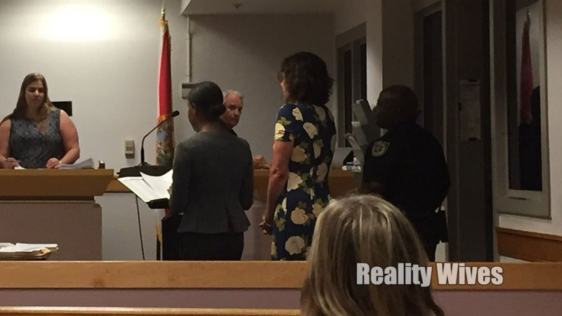 Luann in the floral dress, in front of the judge