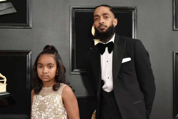 Emani Asghedom & her father Nipsey Hussle at the 2019 Grammy Awards