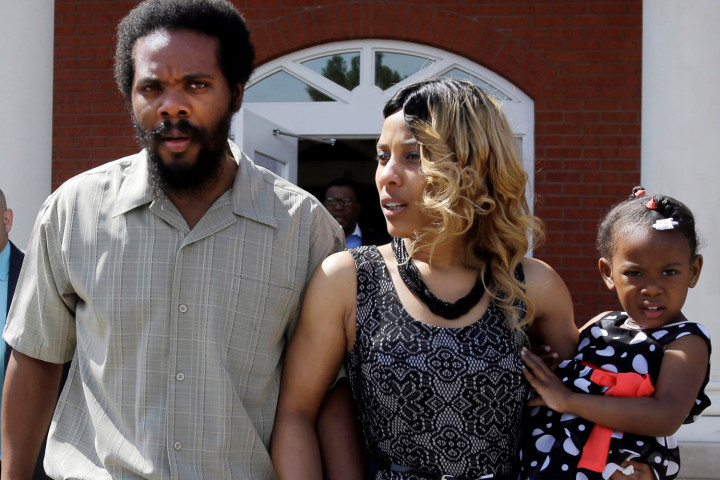 """Cornealious """"Mike"""" Anderson walks out of the Mississippi County Courthouse along with his wife, LaQonna Anderson, daughter Nevaeh, 3."""