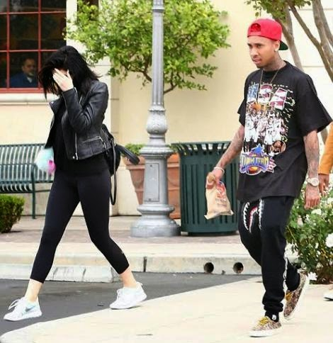 Kylie covering her face was seen with Tyga yesterday