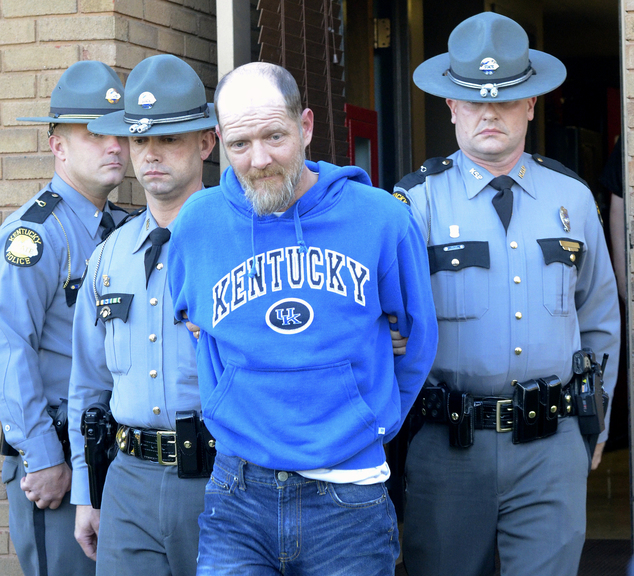Kentucky State Police escort Timothy Madden from State Police Post 3, Friday, Nov. 20, 2015, in Bowling Green, Ky. Madden was arrested Friday and charged with murder and sex crimes in the death of Gabriella Doolin, a 7-year-old Kentucky girl whose body was found in a creek minutes after she disappeared during a football game Saturday night, 15th November. (Joe Imel/Daily News via AP)