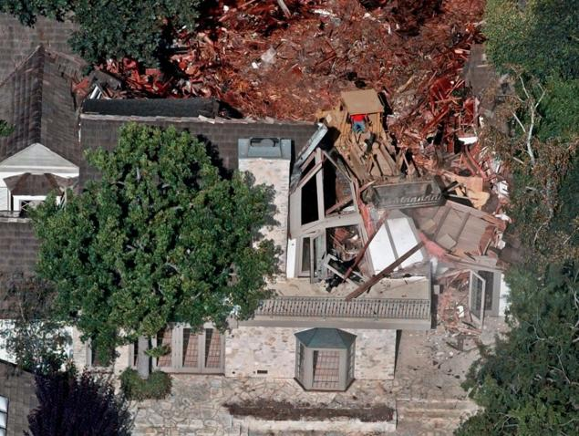 Crews demolish the former home of O.J. Simpson, Wednesday, July 29, 1998, in the Brentwood area of Los Angeles