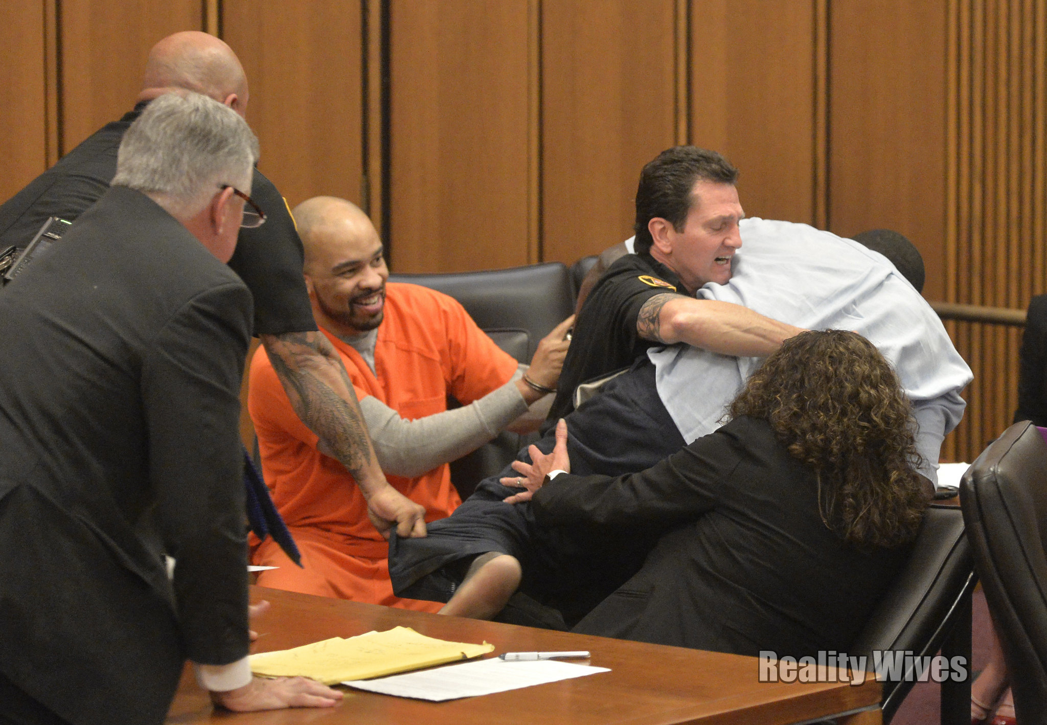 Michael Madison laughs in court